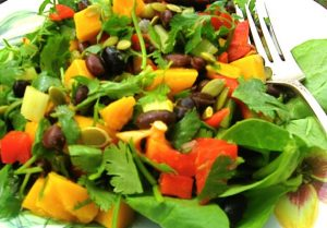 A salad with mango, black beans and a hint of chili perfect for Independence day.