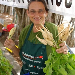 Margie Pikarsky of Bee Heaven Farms stands with vegetable